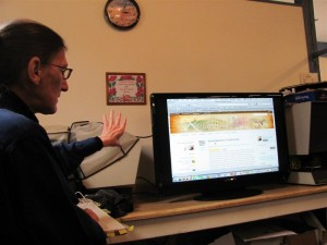 presenter and large screen TV showing Kittanning Online web site